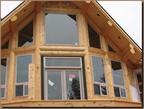 Windows and door installed into log window wall