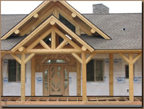 Porch and house gable logs in place